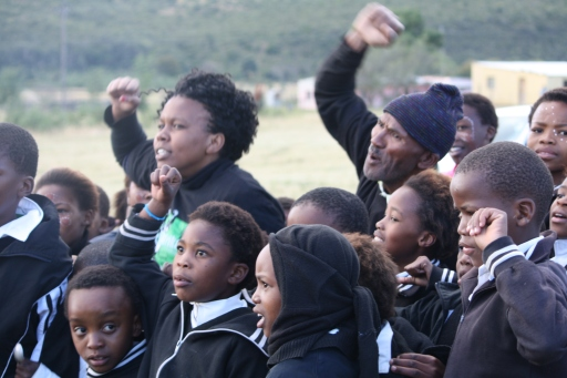 Tshintsha Amakhaya activists lead the children in song