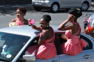 The bridesmaids arrive. Notice that the cellphone is colour-coordinated.